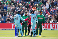 Jason Roy (England) helps umpire Dharmasena to his feet during England vs Bangladesh, ICC World Cup Cricket at Sophia Gardens Cardiff on 8th June 2019