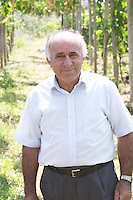 Mr Cobo Sr, the father of the brothers currently running the winery, in the vineyard. Cobo winery, Poshnje, Berat. Albania, Balkan, Europe.