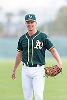 Oakland Athletics designated hitter Kevin Merrell (4) warms up before an exhibition game against Team Italy at Lew Wolff Training Complex on October 3, 2018 in Mesa, Arizona. (Zachary Lucy/Four Seam Images)