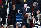 Former President Jimmy Carter and wife Rosalynn walk down the steps during the Inauguration Ceremony of President Donald Trump on the West Front of the U.S. Capitol on January 20, 2017 in Washington, D.C.  Trump became the 45th President of the United States.     <br /> Credit: Pat Benic / Pool via CNP