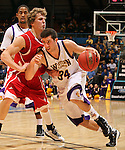 SIOUX FALLS, SD - MARCH 9:  Don McAvoy III #34 from Western Illinois drives against Brandon Bos #12 from the University of South Dakota in the first half of their quarterfinal game Saturday evening at the 2013 Summit League Basketball Tournament in Sioux Falls, SD.  (Photo by Dave Eggen/Inertia)