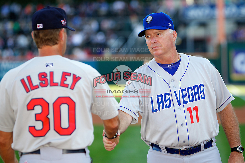Las Vegas 51s manager Marty Brown #11 greets pitching coach Blaise Ilsley #30 of the Memphis Redbirds before the Triple-A All-Star game featuring the Pacific Coast League and International League top players at Coca-Cola Field on July 11, 2012 in Buffalo, New York.  PCL defeated the IL 3-0.  (Mike Janes/Four Seam Images)