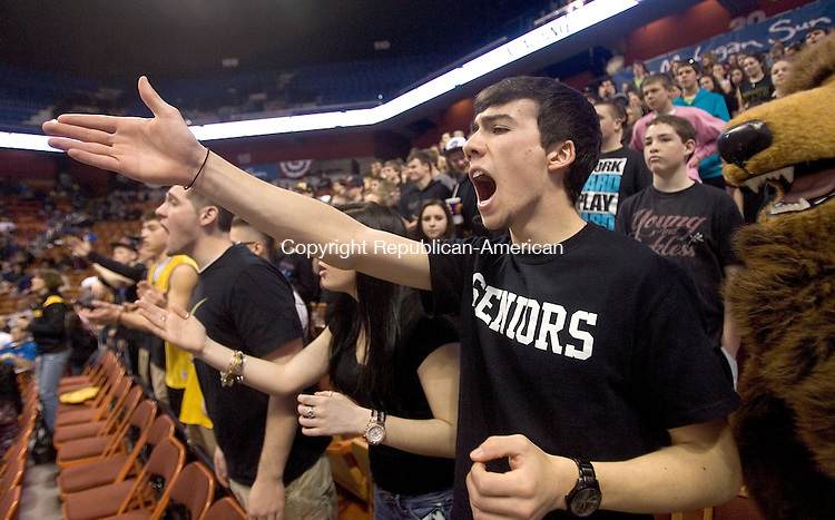 UNCASVILLE, CT. 16 March 2013-031613S15-Zack Simpson, 17, of Thomaston doesn't like a call during the Thomaston High girl's loss to Capital Prep. at Mohegan Sun Arena in Uncasville Saturday. Thomaston lost the CIAC Class S Final  84-55..Steven Valenti Republican-American