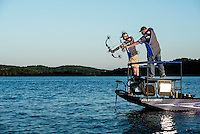 Day one the U.S. Open Bowfishing Championship including a trip onto the lake with Nick Wright (cq, left) and Rich Porter (cq), Friday, May 2, 2014. The event is hosted and sponsored by Bass Pro Shops. The guys are not actually fishing here but rather testing their boat and bows.<br /> <br /> Photo by Matt Nager