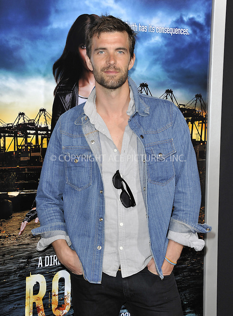 WWW.ACEPIXS.COM....March 26 2013, LA....Lucas Bryant arriving at the 'Rogue' Los Angeles premiere at ArcLight Hollywood on March 26, 2013 in Hollywood, California.....By Line: Peter West/ACE Pictures......ACE Pictures, Inc...tel: 646 769 0430..Email: info@acepixs.com..www.acepixs.com