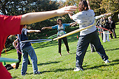 Washington, DC - October 21, 2009 -- First Lady Michelle Obama hula hoops with children during the Healthy Kids Fair on the South Lawn of the White House, Wednesday, October 21, 2009..Mandatory Credit: Samantha Appleton - White House via CNP