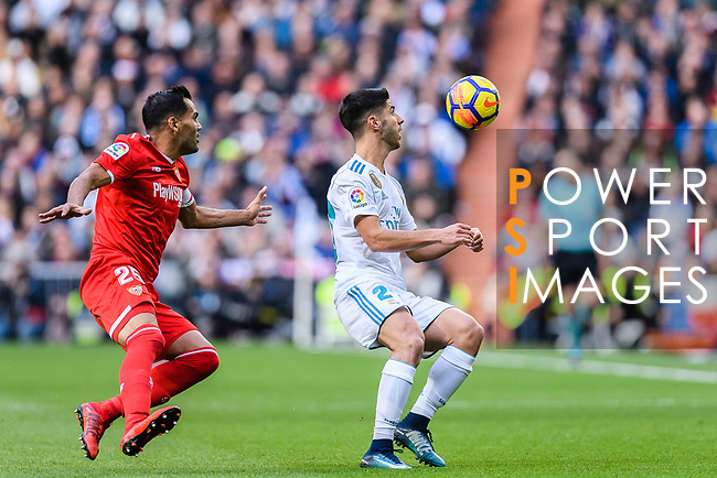 Marco Asensio of Real Madrid (R) in action against Gabriel Mercado of Sevilla FC (L) during the La Liga 2017-18 match between Real Madrid and Sevilla FC at Santiago Bernabeu Stadium on 09 December 2017 in Madrid, Spain. Photo by Diego Souto / Power Sport Images