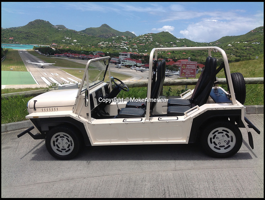 BNPS.co.uk (01202 558833)<br /> Pic: MokeAmerica/BNPS<br /> <br /> The 1960s cult-classic Mini Moke car has been reimagined as an electrically powered beach buggy. <br /> <br /> The original was based on the iconic Mini and produced as a light military vehicle but became popular among the wealthy as a runabout in tropical locations around the world.  <br /> <br /> Celebrity owners included Brigitte Bardot, Princess Margaret, Emperor Rosko and the Beach Boys.  <br /> <br /> The 21st century incarnation, the E-Moke, still boasts the same fantastic 1960s styling but is battery powered and fitted with modern luxuries such as power steering and a modern sound system. <br /> <br /> Offered in seven different colours, the electrically powered vehicle costs £12,500. A gas powered version is also available for a pricier £19,000.