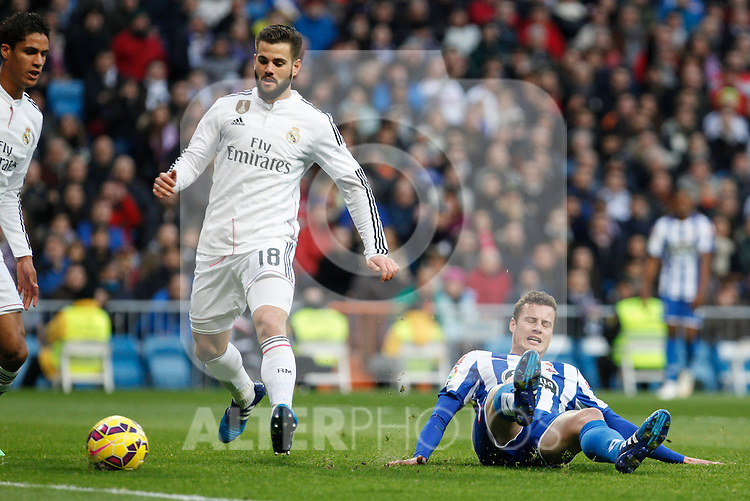 Real Madrid´s Nacho Fernandez and Raphael Varane and Deportivo de la Courna´s Lucas during La Liga match at Santiago Bernabeu stadium in Madrid, Spain. February 14, 2015. (ALTERPHOTOS/Victor Blanco)