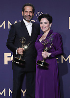 LOS ANGELES - SEPTEMBER 22:  Tony Shalhoub and Alex Borstein with the awards for Outstanding Supporting Actors in a Comedy Series at the 71st Primetime Emmy Awards at the Microsoft Theatre on September 22, 2019 in Los Angeles, California. (Photo by Xavier Collin/Fox/PictureGroup)