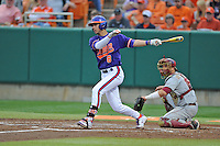 Clemson Tigers third baseman Weston Wilson #8 swings at a pitch during a game against the Florida State Seminoles at Doug Kingsmore Stadium on March 22, 2014 in Clemson, South Carolina. The Seminoles defeated the Tigers 4-3. (Tony Farlow/Four Seam Images)