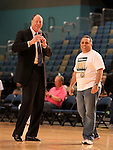 Reno Bighorns Coach Paul Mokeski, left, and owner Herb Santos Jr. thank the crowd at the last home game of the season on Sunday, April 1, 2012 in Reno, Nev. The Idaho Stampede defeated the Reno Bighorns 108-99..Photo by Cathleen Allison