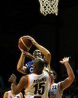 Arthur Trousdell shoots past Link Abrams during the NBL Basketball match between Wellington Saints and Devon Dynamos Taranaki at TSB Bank Arena, Wellington, New Zealand on Friday, 11 April 2008. Photo: Dave Lintott / lintottphoto.co.nz
