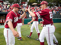 STANFORD, CA - April 23, 2011: Assistant Brock Ungricht of Stanford baseball congratulates Brian Guymon after Stanford's game against UCLA at Sunken Diamond. Stanford won 5-4.