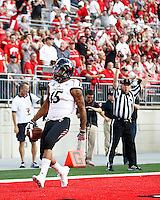 Cincinnati Bearcats wide receiver Chris Moore (15) reacts after scoring the first touchdown in the first quarter of the college football game between the Ohio State Buckeyes and the Cincinnati Bearcats at Ohio Stadium in Columbus, Saturday afternoon, September 27, 2014. As of half time the Ohio State Buckeyes led the Cincinnati Bearcats 30 - 21. (The Columbus Dispatch / Eamon Queeney)
