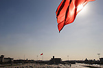The view of a red flag over the Tian An Men Square with Mao Zedong's Mausoleum in background. Beijing. China