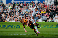 SWANSEA, WALES - APRIL 04: Paul McShane of Hull City  and Wayne Routledge of Swansea City  clash during the Premier League match between Swansea City and Hull City at Liberty Stadium on April 04, 2015 in Swansea, Wales.  (photo by Athena Pictures)