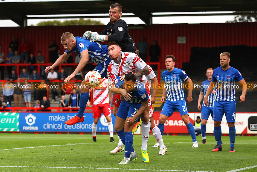Adam Bartlett of Hartlepool United clears from Jack King of Stevenage during Stevenage vs Hartlepool United, Sky Bet EFL League 2 Football at the Lamex Stadium on 3rd September 2016