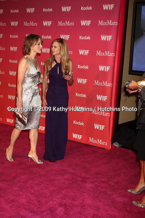 Jodie Foster & Holly Hunter arriving at the Women in Film Annual Crystal & Lucy Awards at the Century Plaza Hotel in Century City , CA on June 12, 2009.  .©2009 Kathy Hutchins / Hutchins Photo