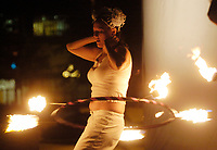 Revo Lution, of Elemental Artistry, performs with fire, after a Parade of Little Angels Saturday night. The event was part of All Souls Procession festivities and took place at the downtown main library, 100 North Stone Ave.