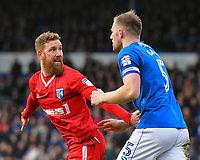 Scott Wagstaff of Gillingham (l) claims a handball against Matthew Clarke of Portsmouth during Portsmouth vs Gillingham, Sky Bet EFL League 1 Football at Fratton Park on 10th March 2018