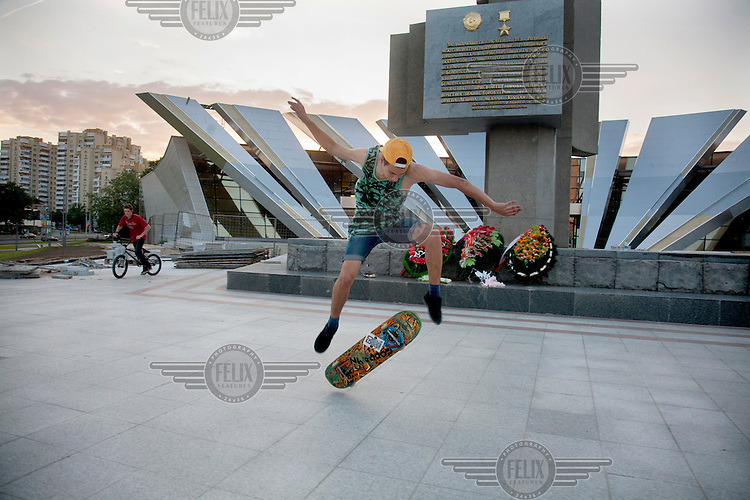 Teenagers skateboard and BMX at one of Minsk's monuments.