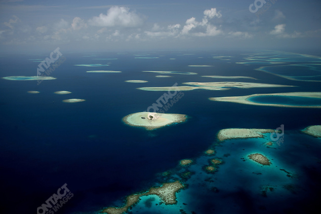 Some of the 1,192 islands and atolls that constitute the Republic of the Maldives, an archipelago that is the lowest-lying country in the world: the average elevation of the republic is about 3 feet above sea level. The Maldives, April 2005.
