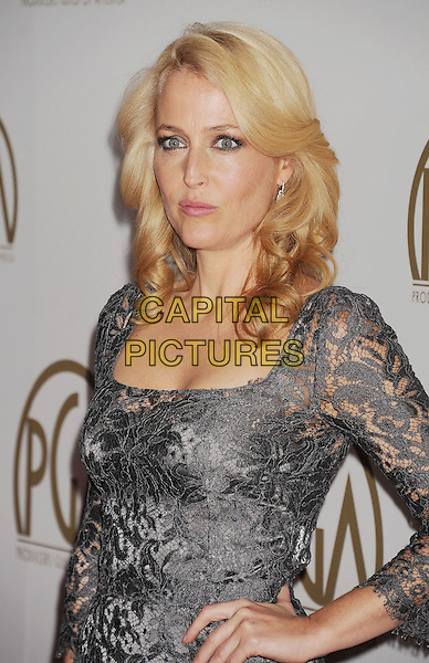 BEVERLY HILLS, CA- JANUARY 19: Actress Gillian Anderson  arrives at the 25th Annual Producers Guild Awards at The Beverly Hilton Hotel on January 19, 2014 in Beverly Hills, California.<br /> CAP/ROT/TM<br /> &copy;Tony Michaels/Roth Stock/Capital Pictures