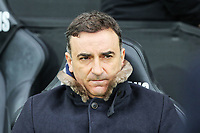 Swansea manager Carlos Carvalhal sits on the bench during the Premier League match between Swansea City and West Ham United at The Liberty Stadium, Swansea, Wales, UK. Saturday 03 March 2018
