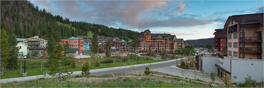 In the early morning, ski base at Winter Park, Colorado, still sleeps. This image is a panorama made of up several pictures to show the wide landscape of this Colorado ski town.