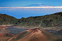 Dusting of snow on the summit of Mauna Loa on the Big Island with a cinder cone in the crater of HALEAKALA NATIONAL PARK on Maui in Hawaii