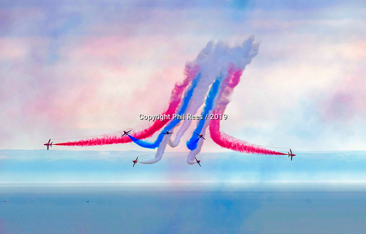 The RAF Red Arrows performing at the Wales Airshow over Swansea Bay this afternoon.