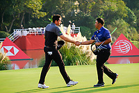 Keegan Bradley (USA) shakes hands with Kiradech Aphibarnrat (THA) on the 18th green during the 3rd round at the WGC HSBC Champions 2018, Sheshan Golf CLub, Shanghai, China. 27/10/2018.<br /> Picture Fran Caffrey / Golffile.ie<br /> <br /> All photo usage must carry mandatory copyright credit (&copy; Golffile | Fran Caffrey)
