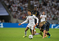 Dele Alli of Tottenham Hotspur goes over under pressure from Kamil Glik (right) of Monaco & Tiemoue Bakayoko of Monaco during the UEFA Champions League Group stage match between Tottenham Hotspur and Monaco at White Hart Lane, London, England on 14 September 2016. Photo by Andy Rowland.