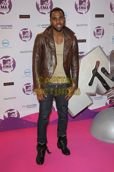 Jason Derulo.MTV European Music Awards EMA, Odyssey Arena, Belfast, Northern Ireland 6th November 2011.full length jeans denim beige top brown leather jacket beard facial hair .CAP/PL.©Phil Loftus/Capital Pictures.