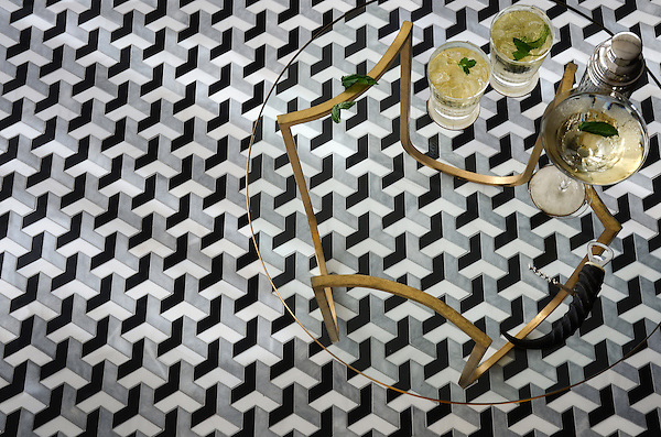 Francois Grand, a waterjet mosaic shown in  honed Chinese Black, honed Allure, and polished Dolomite, is part of the Illusions® collection by New Ravenna.