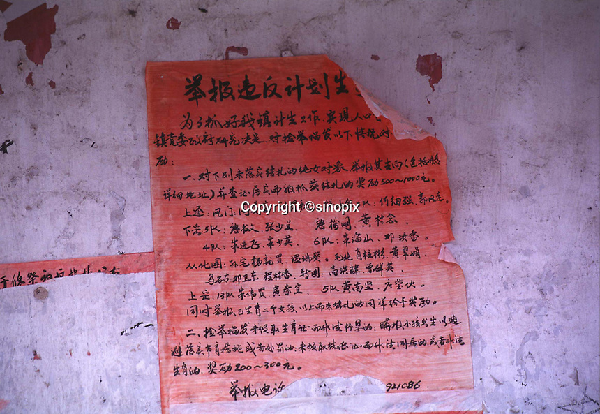 A one child policy notice on the wall in China. Spreading one child policy throughout China.
