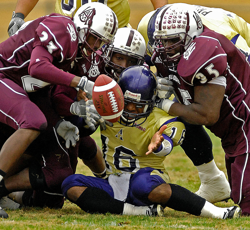 Fumble by Alcorn State's quarterback Chris Walker (16) is recovered by A&M's Antonio Nelson (23).  Alcorn State vs. Alabama A&M University football at Alabama A&M.  Bob Gathany / The Huntsville TImes