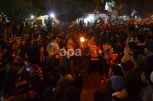 "Fans of Al Ahly football club celebrate after their Egyptian Premier League derby soccer match against El Zamalek at Borg El Arab ""Army Stadium"" near Alexandria, Egypt, February 9, 2016. Photo by Amr Sayed"