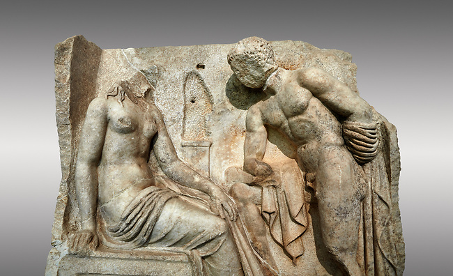 "Close up of a Roman Sebasteion relief  sculpture of Io and Argos Aphrodisias Museum, Aphrodisias, Turkey. <br /> <br /> A powerful hero is folding a sword gazing closely at a half naked and dishevelled young heroine who sits on a chest like stool. Between, on a pillar base stood a small, separately added statue of a goddess ( now missing). The scene follows a scheme used in the relief panels ""Io guarded by Argos"". Io was one of Zeus's lovers, and Argos was a watchful giant sent to guard her by Hera, Zeus's wife."