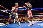 Uncasville, CT: (l-r) Paulie Malignaggi lands on  Lovemore N'Dou during their IBF Junior Welterweight Championship at the Mohegan Sun casino, June 16th, 2007. Malignaggi won the belt from N'Dou by unanimous decision.. Photo by Thierry Gourjon.