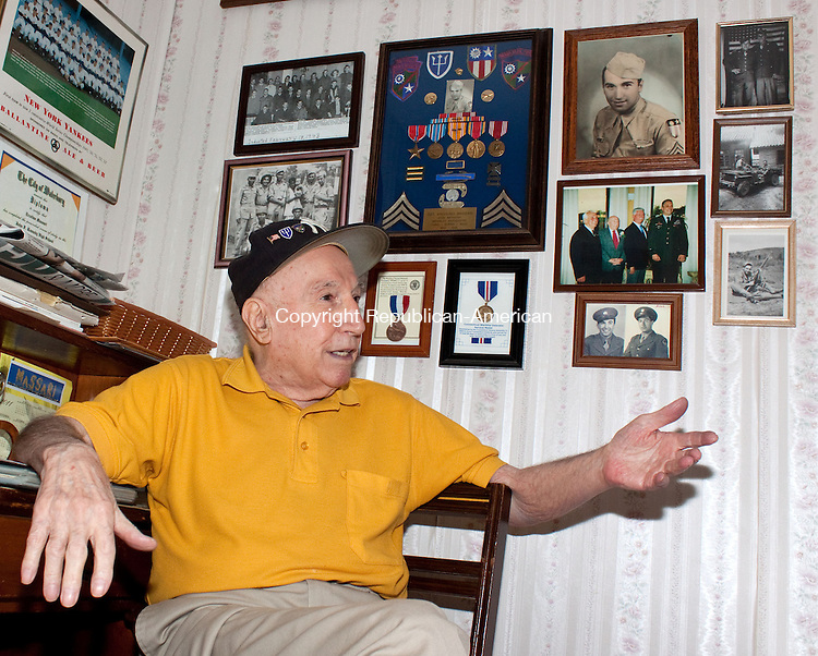 WATERBURYCT.-01 DECEMBER 2011 120111DA01- Eric Massari, a Waterbury man and World War II vet who is one of the last remaining &quot;Merrill's Marauders&quot; who freed Burma from the Japanese, recently received a thank-you letter from a Chinese student. Massari sits in his home on Thursday and recounts the days when he served as war memorabilia hangs above him.<br /> Darlene Douty Republican American.