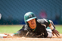 Hawaii Rainbow Warriors outfielder Kaeo Aliviado (2) dives back to first base during Houston College Classic against the Baylor Bears on March 6, 2015 at Minute Maid Park in Houston, Texas. Hawaii defeated Baylor 2-1. (Andrew Woolley/Four Seam Images)