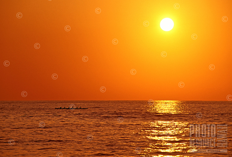 A beautiful golden sunset reflected in the Pacific Ocean off Kona on the Big Island of Hawaii.