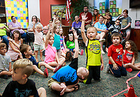 NWA Democrat-Gazette/CHARLIE KAIJO Kids raise their hands to be part of a magic show, Thursday, July 5, 2018 at the Bella Vista Public Library in Bella Vista. <br /><br />Tommy Terrific performed a musical magic show for youth.