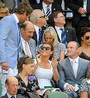 OIC - ENTSIMAGES.COM -   Coleen Rooney and Wayne Rooney watch Andy Murray of Great Britain celebrates his win in the Gentlemen's Singles Final match against Novak Djokovic of Serbia of the Wimbledon Lawn Tennis Championships at the All England Lawn Tennis and Croquet Club 7th July 2013     Photo Ents Images/OIC 0203 174 1069