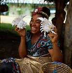 Tongan lady showing shells, Nuku'lofa, Tonga, South Pacific, 1980.
