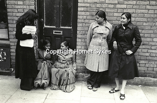 Grunwick Strike North London UK. 1977. Women on left is holding a &quot;Grunwick Strike Committee APEX&quot; leaflet.<br /> <br /> Nirmal Ram sits on the doorstep (left) if you know the names of the other people please get in touch.<br /> <br /> Name thanks to Graham Taylor.