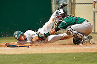 April 23, 2011:    Jacksonville University Dolphins catcher Alex Swenson (14) slides safely under the tag of Stetson Hatters catcher Nick Rickles (9) during Atlantic Sun Conference action between Stetson Hatters and Jacksonville University Dolphins at John Sessions Stadium in Jacksonville, Florida.  Jacksonville defeated Stetson 10-4...........