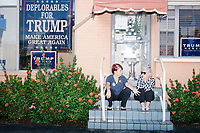 Zoila Oliva, 76, (right) and Inez Yimoc, 55, both of Hialeah, talk about what they think might happen if Trump doesn't win at the Donald Trump campaign office in Hialeah, Miami, Florida.  The two were volunteering in the campaign phone bank.